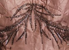 Worth Dress - detail - 1950's - Labelled: 'Worth. 50 Grosvenor Street, London' - Shell pink slubbed silk, bodice and front of the skirt are decorated with silver strass embroidery and silver sequins in the shape of long leaves and floral fronds - © Leicestershire County Council - @~ Mlle