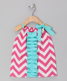 A delightful blend of colors, chevrons and pretty details gives this dress a unique flair that will inspire cuties to do a happy dance. With comfy cotton fabric and a bow-embellished adjustable neckline, it gives little beauties looking to boogie no trouble at all. 100% cottonMachine wash; tumble dryMade in the USA<...