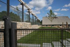 The darkened bronze wire mesh fence surrounds this beautiful property.<br />The lock crimp wire mesh in a fence application provides an elegant but strong looking barrier. Brick Fence, Front Yard Fence, Farm Fence, Cedar Fence, Dog Fence, Concrete Fence, Pallet Fence, Bamboo Fence, Fence Landscaping