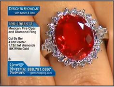 WOW - now thats what a Mexican fire opal should look like. Intense orange and crisply transparent set with white diamonds in 18k white gold.  Mighty fine!