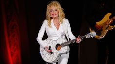 """Parton and """"Coat of Many Colors"""" star Alyvia Alyn Lind talk music and, of course, puppies during their round of Chatter. The legend also shares that she can't resist singing """"I Will Always Love You"""" in the shower. (Photo credit: Getty)"""