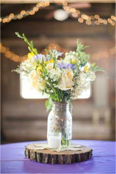 I know I want fresh flowers at my wedding. And mason jars are way cooler than cheesy vases anyway! Can't wait to have a simply beautiful arrangement at the center of each table, which the guests can take home!
