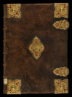 This binding is made of brown leather on wood. Several locks are on a red velvet. It's decorated with palm tree and wings. #manuscript #bookcover #cover #binding #medieval #leather #velvet
