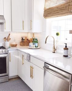 Bright and airy white kitchen design with gold faucet and cabinet pulls, single basin sink, blue accents, white subway tile, and bamboo roman shade Home Decor Kitchen, Interior Design Kitchen, New Kitchen, Home Kitchens, Kitchen Ideas, Interior Paint, Retro Kitchens, Kitchen Office, Kitchen Themes