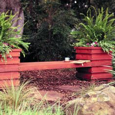 DIY planter benches for seating around outdoor dance floor? Fill with plants that match overall floral theme.