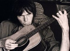 doesn't look like much but it's neil young holding his martin D28, the ultimate guitar !