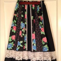Vintage Boho Skirt  Discounted Ship 1 hr Adorable vintage 1970s boho skirt  Black..lace.. pink floral pattern  Elastic waist   Light and airy! Comfy!  Cotton with white cotton lining  No size indicated   Measurements   11 inch waist across front (17 inches with elastic stretched. )  28 inches long Carefree Fashions Skirts A-Line or Full