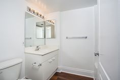 Bay Parc Apartments in Miami, FL offers pet-friendly and smoke-free apartments with wood flooring, modern kitchens and resort-style pools, near Bayfront Park. 2 Bedroom Apartment, Wood Flooring, Bathroom Medicine Cabinet, New Homes, Mirror, Modern, Home Decor, Trendy Tree, Decoration Home