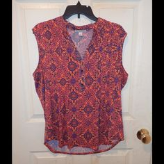 Cute summer blouse Abstract print blouse with four gold buttons down the front soft and stretchy material has navy blue pink purple and main color is orange very good condition Established 1962 Tops Blouses