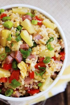 Fried rice that is loaded with sweet pineapple, ham and veggies that is so much better than take out! We made the mistake of actually ordering chinese take out last week. I was just too tired to m…
