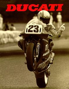 Doug Polen of the Fast By Ferracci Ducati Team. Met him at Sears Point Racetrack. Multiple time Superbike champion on a Ducati. Very nice guy from Texas. Got his autographed pic on my garage wall.