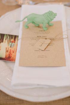 animal figurine wedding decor - photo by Piteira Photography http://ruffledblog.com/whimsical-destination-wedding-in-lisbon #weddingideas #animalfigurine #placesetting