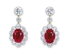 A SUPERB PAIR OF PIGEON'S BLOOD MOGOK RUBY AND DIAMOND EAR PENDANTS. Each set with an oval-shaped ruby, 10.02 and 9.09 carats, within a circular-cut diamond surround, to the similarly-cut diamond surmount and spacer, mounted in platinum and gold.