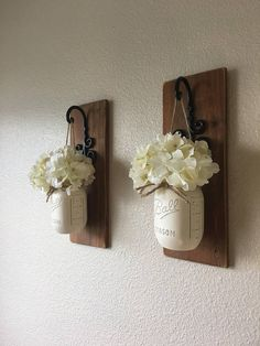 These rustic country style mason jar sconces are the perfect touch to your home decor. They bring warmth and beauty to any room. This listing is for 2 Sconces so for each quantity of one at checkout you are ordering one set of 2. LEAVE ME A NOTE IN THE NOTE TO SELLER BOX AT