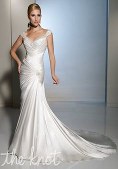 Gown features beading and corset back. By Sophia Tolli