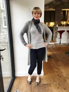 An outfit of greys for a grey Winter day. The snow leopard print shoes and the spotted silk scarf add lift to an otherwise classic outfit. Midlifechic is a UK style blog for women over 40.