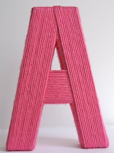 """yarn wrapped letter - I didn't use a tutorial for this. It is much harder than you would think to get it to look good! one small sugar & cream ball of yarn covered a thin 12""""x6"""" letter from Michael's."""