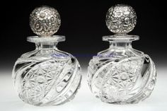 Pair of cologne bottles in brilliant cut clear glass with swirled Daisy and Button pattern and repousse silver  stoppers poss. by Hawkes or Hoare, USA end of 19th Cent.