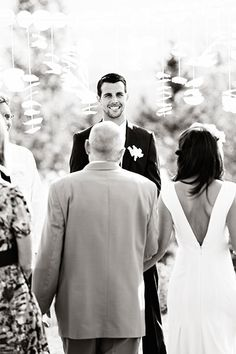 Would love to have a pic from behind the bride, looking at the grooms face when he first sees her