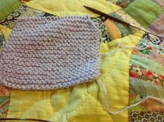 """Just started another baby sweater. Using simple baby jacket in garter stitch from Eileen Casey at about.com. It says """"brand new knitters will be able to tackle this sweater, even if you just learned this morning.  So far, so good."""