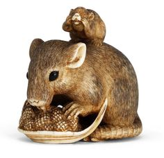An ivory netsuke of a rat and young After Okatomo, Edo period (1615-1868), 19th century