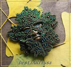 bestiARTiusz; Green Man; soutache mask brooch; broszka maska sutasz; face FIMO Earrings Handmade, Handmade Jewelry, Owl Feather, Soutache Necklace, Beading Patterns Free, Victorian Jewelry, Green Man, Diy Jewelry Making, Bead Art