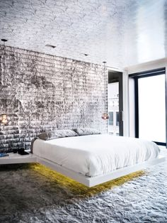 Modern #bedroom with exposed walls and floor #lighting