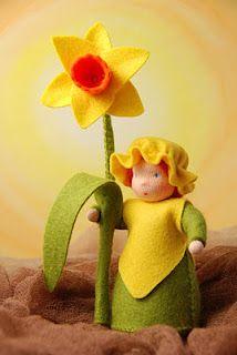 Little felt daffodil doll
