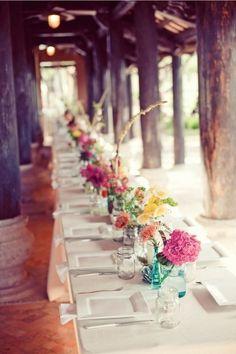 Square white plates, mason jars, colorful flower arrangements - housewarming or summer party