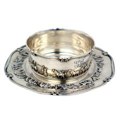 Childs Sterling Bowl & Plate  American  Circa 1900  A charming sterling bowl and plate featuring the story of Noah's Ark in relief. Gifts like these where made only to the wealthiest children when a silver spoon simply was not good enough