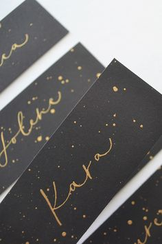 Place cards x with gold lettering on black card stock with gold detail - first name only.