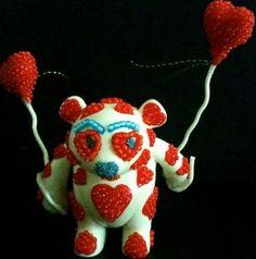 Artist Denise Vasquez created her custom Glow in the dark LOVE Yoka for DKE/Adfunture gallery tour