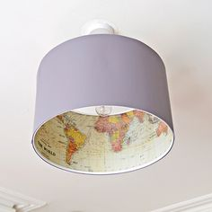 Ikea lamp hack - Decoupage a world map on the inside of an Ikea Rismon lamp to turn it into something special.