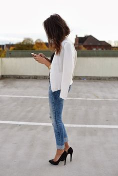 I just love this! There's something about this classic causal destroyed denim with a crisp white blazer and pumps