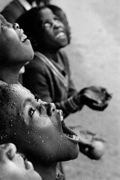 Chris Steele-Perkins. SOUTHERN AFRICA. Lesotho. School children during a rainstorm. 1981
