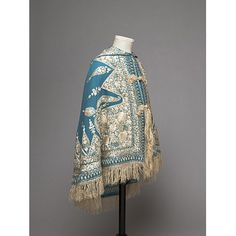 Twilled peacock blue woollen cloth, embroidered in cream silk thread, with a cream tassel on the hood; Anglo-Indian ?, 1860-70