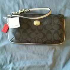 Coach wristlet Brown and tan coach wristlet Coach Bags Clutches & Wristlets