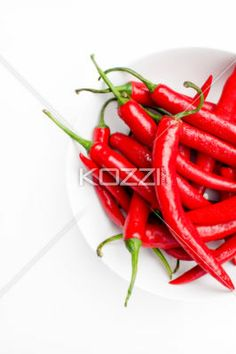 Cut Off Bowl of Chilli Peppers - A bunch of red hot chilli peppers in a bowl on white