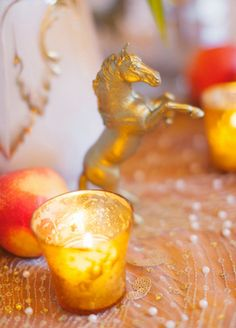 table scape golden horse red orange gold yellow photo by heather waraksa