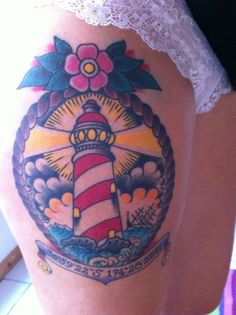 Color lighthouse thigh tattoo