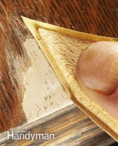 Sanding the epoxy  Sand carefully to avoid removing the surrounding finish. Make a detail sander by gluing sandpaper to a thin strip of wood.