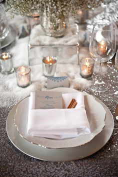 place setting, i like the candles with the fake snow for a winter table scape