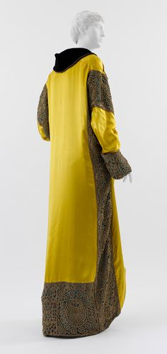 Opera coat, 1912  Paul Poiret (French, 1879–1944)  Yellow and pale blue silk satin, black silk velvet, turquoise silk satin with gold and silver filé crocheted overlay, and silver filé trapunto half-belt and trim. Back