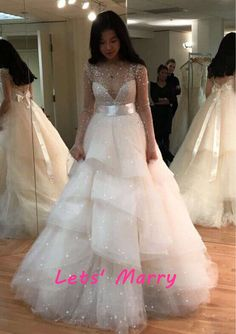 Find More Wedding Dresses Information about Factory Luxury Pearls Beaded Sequined Ivory Wedding Dresses 2016 Roral Train Scoop Satin Bow Belt Long Sleeves Bridal Dresses,High Quality dress lily,China dress up games lingerie Suppliers, Cheap dress long sleeve tunic dress from Let's Marry on Aliexpress.com