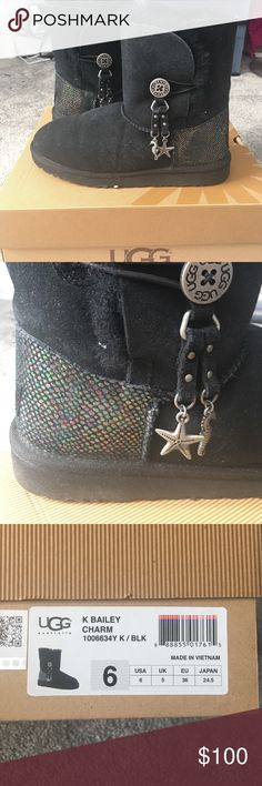 Real Ugg Boots Black with seahorse and starfish charms. Multi color shimmer heel. Might have worn once. In excellent condition and have been water proofed. UGG Shoes Winter & Rain Boots