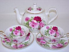 Lovely Floral  Teapot with matching Teacups and Saucers