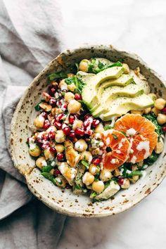 Winter Spa Salad with Lemon Chicken! Loaded with chickpeas, spinach, pomegranates, Cara Cara oranges, avocado, shallots, herbs, dressing, and lemon chicken. #glutenfree #sugarfree #salad #healthy #saladrecipe | pinchofyum.com