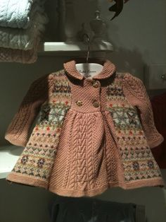 Love the combination of fair isle and cables. I could definitely see knitting a variation of this sweater for Addie.