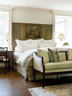 .gorgeous headboard...love the writing desk as a bedside table.