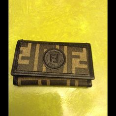 Authentic Fendi  key holder. MARKDOWN Never used AUTHENTIC Fendi key holder this also has a compartment for dollar bills. Also a zipper for maybe change and credit cards. FENDI Accessories Key & Card Holders